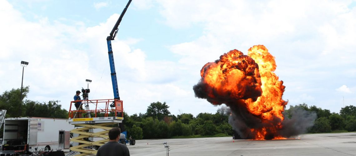 Bionic_Images_Chris_Wells_with_film_crew_filming_explosion_outside_on_concrete